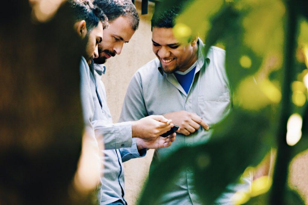 Men watching a video